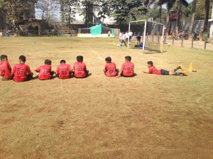 Boys' team waiting at the sidelines